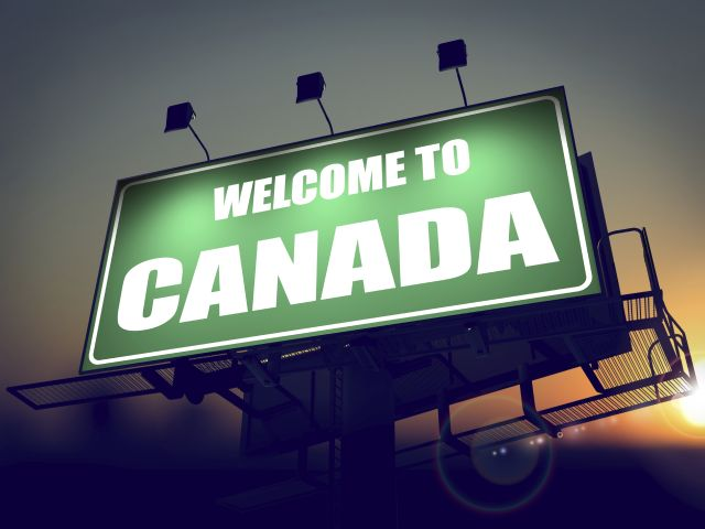 Welcome to Canada - Green Billboard on the Rising Sun Background.